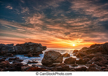 Sunset over a rocky beach in Australia