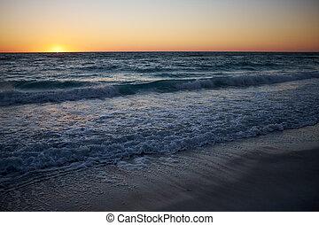 Sunset over a sandy beach on Anna Maria island