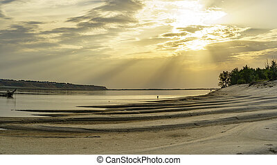 Sunset over a sandy beach on the Volga river, Russia.