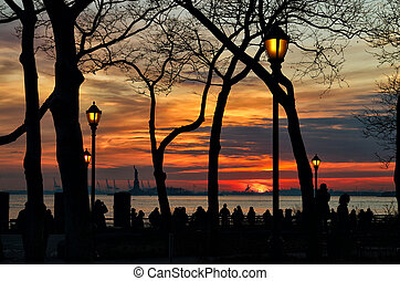 Sunset over a Statue of Liberty.