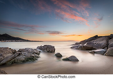 Sunset over Algajola beach in Corsica