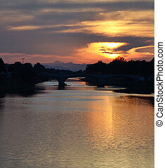 Sunset over Arno river