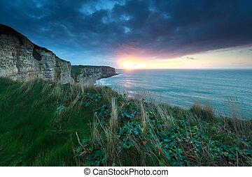 sunset over Atlantic ocean rocky coast