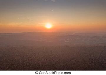 Sunset over Autumn forest. Aerial view autumn landscape