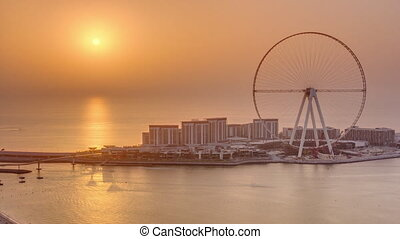 Sunset over Bluewaters Island in Dubai aerial timelapse.