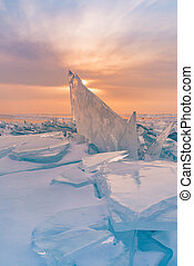 Sunset over breaking Ice in Baikal water lake winter season