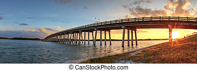 Sunset over Bridge along Estero Boulevard, crossing over New Pass from Estero Bay in Bonita Springs