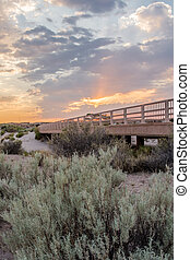 Sunset Over Bridge in Desert