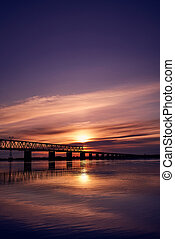 Sunset over bridge through Zeya river
