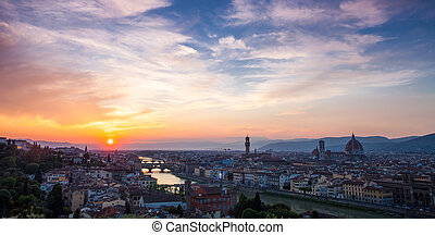 Sunset over bridges through the river Arno in Florence