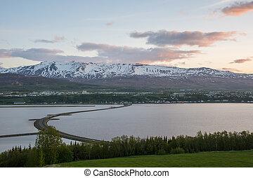 Sunset over city of Akureyri in Iceland