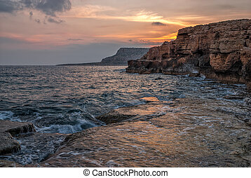 Sunset over cliffs and ocean