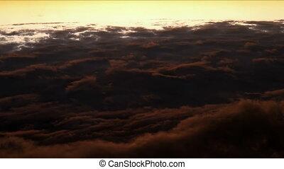 Flight above fluffy clouds