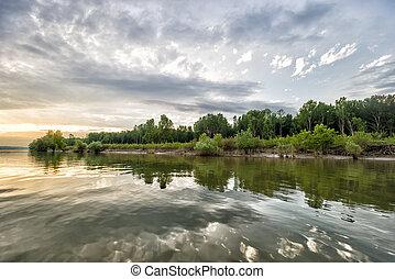 sunset over danube river in galati, romania
