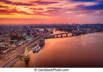 Dramatic colorful sunset over Dnipro river in Kiev, Ukraine, travel background