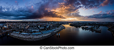 Dramatic colorful sunset over Dnipro river in Kiev, Ukraine, travel background. Big panorama from drone