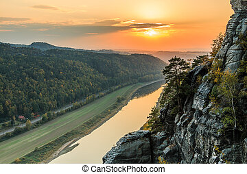 Sunset over Elbe valley with rocks