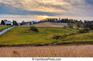 Sunset over farm fields and hills in Lancaster County, Pennsylvania.