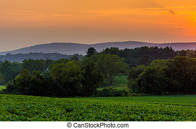 Sunset over farm fields and the Piegon Hills, near Spring Grove, Pennsylvania.