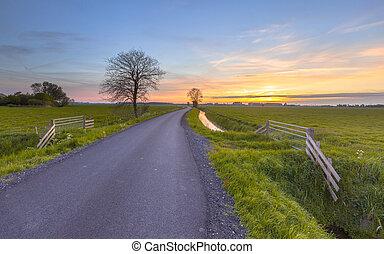 Sunset over farmland Groningen