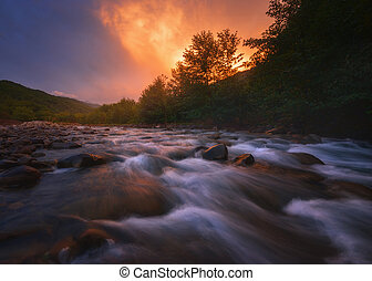 sunset over fast mountain river
