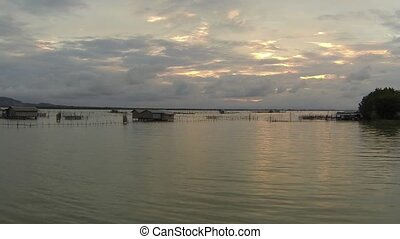 Sunset over fishermen water village in Thailand. Aerial video