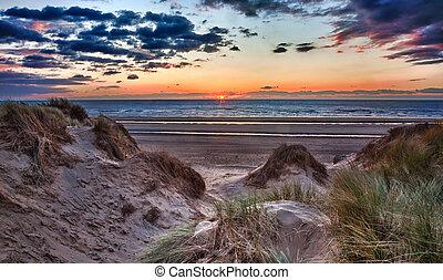 Sunset over Formby Beach through dunes