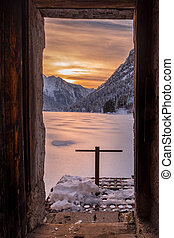 Sunset over frozen and snow covered lake Predil in winter -...
