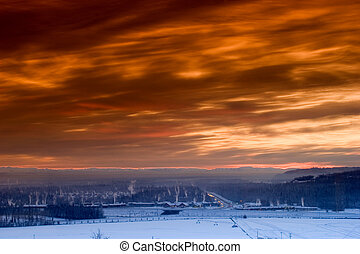 Nov. 28, 2005, Fairbanks, Alaska. Sunset over frozen at -35C (-30F) Fairbanks town. Ice fog, plumes from house heaters and red skies