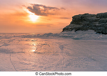 Sunset over frozen water lake Siberia Baikal Russia