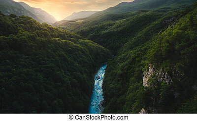 Sunset over Hills with River Canyon