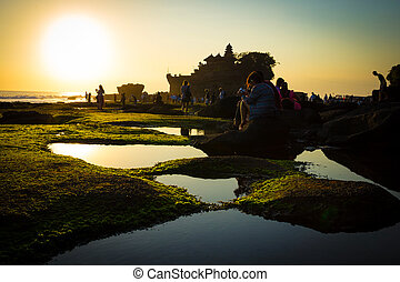 Sunset over hindu temple Pura Tanah, Bali, Indonesia