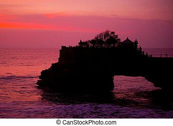 sunset over hindu temple Pura Tanah Lot, Bali
