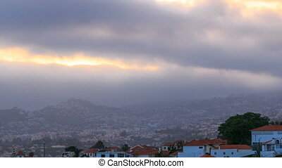 Sunset over houses from hill in Funchal, Madeira, Portugal...