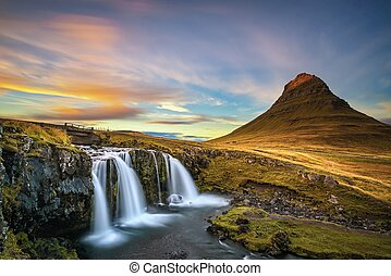 Sunset over Kirkjufellsfoss Waterfall in Iceland