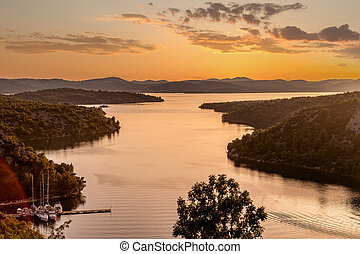 Sunset over Krka River and Lake Prokljan in Croatia