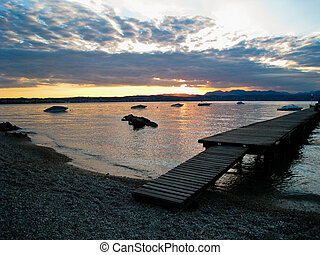 Sunset over Lago di Garda, Italy with Boats and Dock