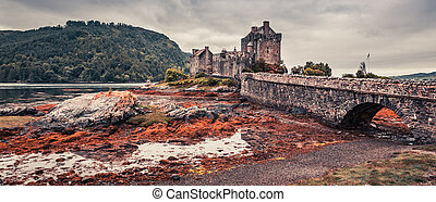 Sunset over lake at Eilean Donan Castle in Scotland