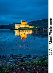 Sunset over lake at Eilean Donan Castle, Scotland, United ...