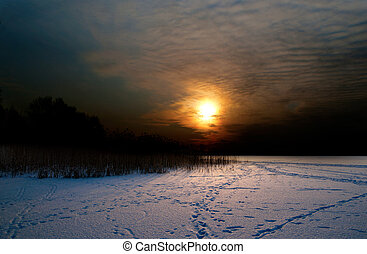 Sunset over lake in winter