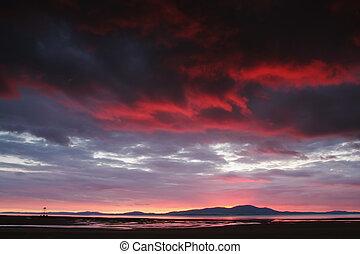 Sunset over mountain at beach