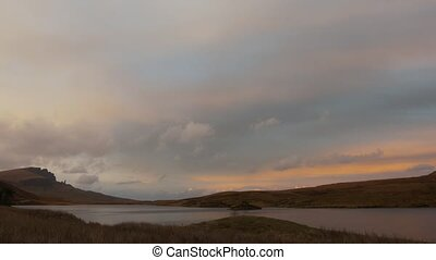 Sunset over mountain lake in Scotland, time-lapse