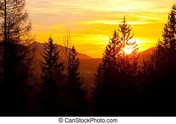 Sunset over mountain landscape horizon