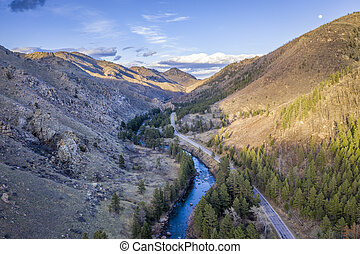 sunset over mountain river canyon aerial view