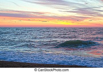sunset over ocean in summer