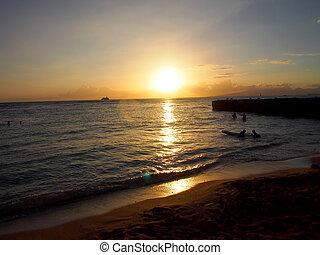 Sunset over ocean seen from Beach