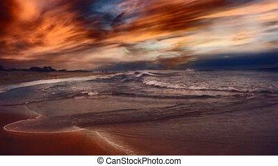 Beautiful sunset over ocean shore