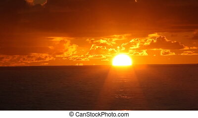 sunset over ocean timelapse - sun setting over the ocean...