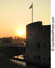 Sunset over old fort in Holland - The sun sets at fort...