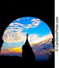 Sunset over pagoda in Myanmar